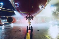Deicing of the airplane Stock Photos