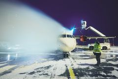Deicing of the airplane. Airport in winter. Deicing of the airplane before flight Royalty Free Stock Photo