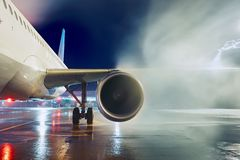 Deicing of the airplane. Airport in winter. Deicing of the airplane before flight Royalty Free Stock Photography