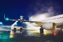 Deicing of the airplane. Airport in winter. Deicing of the airplane before flight Royalty Free Stock Photos