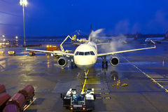 Deicing of the Lufthansa plane Royalty Free Stock Photos