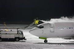 Deicing passenger airplane at night. Deicing passenger aircraft at night Royalty Free Stock Photos