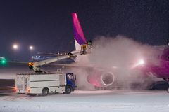 Deicing plane with glycol Royalty Free Stock Photo