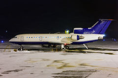 Deicing plane processing. In the night airport Royalty Free Stock Image