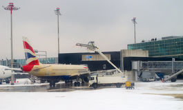 Deicing plane before take-off royalty free stock photo