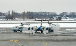 Deicing treatment wing aircraft in Boryspil Airport. Kiev, Ukraine. Deicing treatment wing aircraft in Boryspil International Airport, the countrys largest Royalty Free Stock Photo