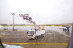 Deicing truck deices a plane before. MUNICH, GERMANY - OCTOBER 17: Deicing of a plane before take off on October 27,2012 in Munich, Germany. The deicing applied Stock Images