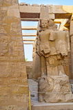 The deity Amun Ra in Karnak Temple. The ruins of statue of the deity Amun Ra in the Hypostyle Hall of Karnak Temple, Luxor, Egypt Stock Photo