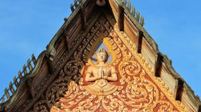 Deity in front of temple roof Royalty Free Stock Photos