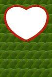 Deja el marco en forma de corazón. Foto de archivo