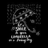 deje una sonrisa ser su paraguas en un día lluvioso Foto de archivo