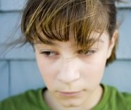 Dejected. Photo of Maggie against blue wall Stock Image