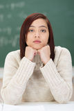 Dejected attractive young Asian student Royalty Free Stock Photo