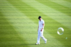 Dejected English Cricketer looks down. SYDNEY,AUSTRALIA - JANUARY 4: Dejected English Cricketer looks down after missing a catch in the 2nd day of the last Ashes royalty free stock images