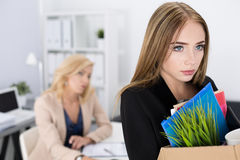 Dejected fired office worker carrying a box full of belongings Royalty Free Stock Photos