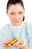 Dejected ill woman holding pills Stock Photography
