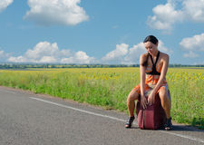 Dejected woman waiting for a lift Royalty Free Stock Photos