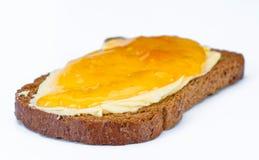 Dekkingstoost met boter en jam Royalty-vrije Stock Foto's