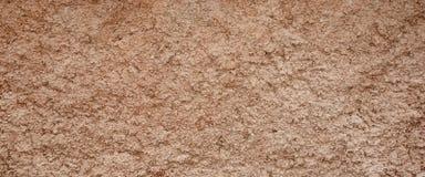 Dekoracyjna Brown Barwiąca Groszkująca Cementowa tynk ściana Szeroki Backgr zdjęcia stock