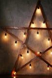 Dekoracyjna gwiazda z starymi lampami Fotografia Royalty Free