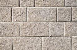 Dekoracyjne reliefowe powlekanie cegiełki imituje granit na ścianie Zdjęcie Royalty Free
