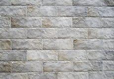 Dekoracyjne reliefowe powlekanie cegiełki imituje kamienie na ścianie Fotografia Royalty Free