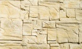 Dekoracyjne reliefowe powlekanie cegiełki imituje kamienie na ścianie Obrazy Stock