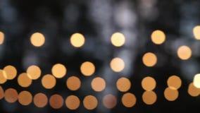 Dekoracyjny plenerowy sznurek zaświeca obwieszenie w ogródzie przy nocy lub wieczór czasem zbiory