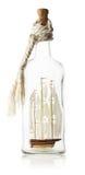 Dekoracyjny statek w szklanej butelce odizolowywającej na białym tle Obrazy Royalty Free