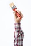 Dekorateur, der einen Malerpinsel hält stockfotos