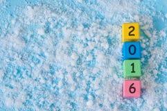 Dekoration des neuen Jahres mit 2016 auf Schneehintergrund Lizenzfreie Stockfotos