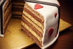 Dekoration eines Jahrestags-Kuchens Lizenzfreie Stockfotografie