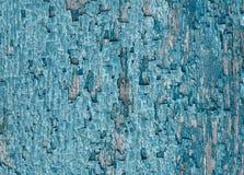 Dekorativ bakgrund med textur av gamla spruckna blått målar på Arkivfoto