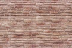 Dekorativ brun tegelstenvägg som bakgrund eller textur royaltyfri foto