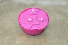 Dekorativ glasyr på kaka för muffin Royaltyfria Bilder