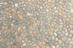Dekorativ golvmodell av grusstenar Royaltyfria Foton