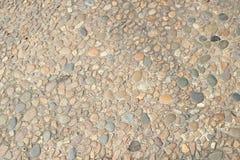 Dekorativ golvmodell av grusstenar Arkivbild