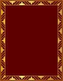 Dekorativ guld- ram på en röd bakgrund Arkivfoton