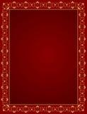 Dekorativ guld- ram på en röd bakgrund Royaltyfri Foto
