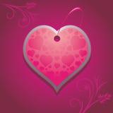 Dekorativ hjärta på den purpurfärgade bakgrunden Royaltyfria Foton
