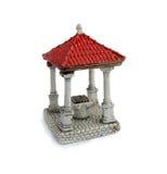 Dekorativ miniatyr - stenbrunnar som isoleras på vit bakgrund Royaltyfria Bilder