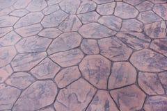 Dekorativ modellnatur av den sömlösa gamla bruna stenarkgångbanan för bakgrund eller textur royaltyfri foto
