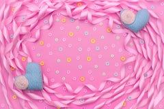Dekorativ ram av satängbandrosa färger Fotografering för Bildbyråer