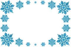 Dekorativ ram för jul av blåa snowflakes. royaltyfri foto