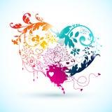 Dekorativ regnbågehjärta med blom- beståndsdelar. Arkivfoton