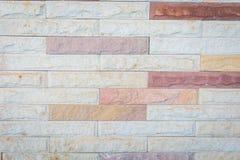 Dekorativ tegelstenvägg, bakgrund Arkivfoto
