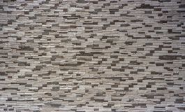 Dekorativ tegelstenvägg från konkreta belägen mitt emot tegelplattor som bakgrund eller textur Arkivfoton