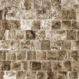 Dekorativ texturerad bakgrundsvägg av marmortegelplattor Arkivbilder