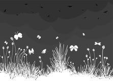 Dekorativ trädgård med fåglar och fjärilen Arkivfoto