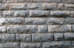 Dekorativ vägg av stenar och tegelstenar royaltyfri bild